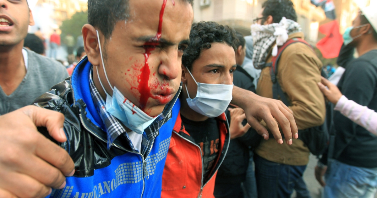 An injured Egyptian protester is helped away on the third day of clashes at Tahrir Square in Cairo on November 21, 2011. Fresh violence erupted between police and protesters demanding the end of army rule, as the ruling military council faced its worst crisis since Hosni Mubarak was toppled.</p>
