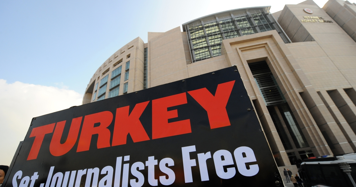 A placard is pictured during a protest gathering journalists and human right activists in front of the courthouse in Istanbul during the trial of two prominent Turkish journalists Ahmet Sik and Nedim Sener on Nov. 22, 2011.</p>