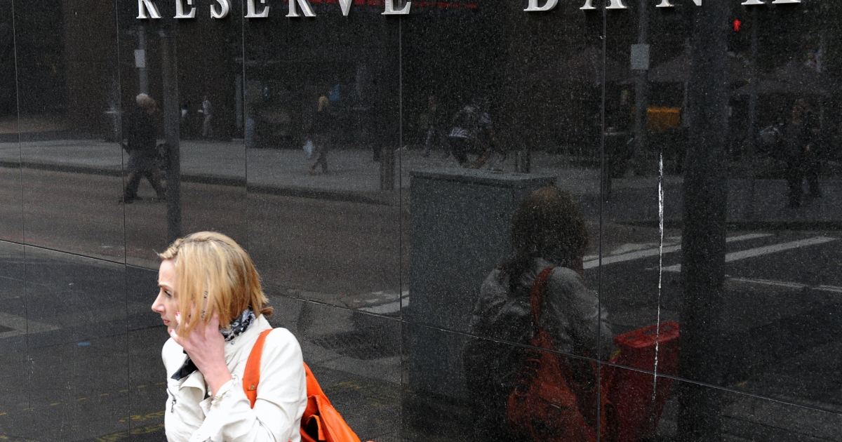 A woman passes the Reserve Bank of Australia in Sydney on December 6, 2011 as official rates were slashed by 25 basis points for the second month in a row. Australians were handed an early Christmas present December 6 when the central bank cut interest rates for the second month in a row, but it warned the slowing global economy continued to pose risks.</p>