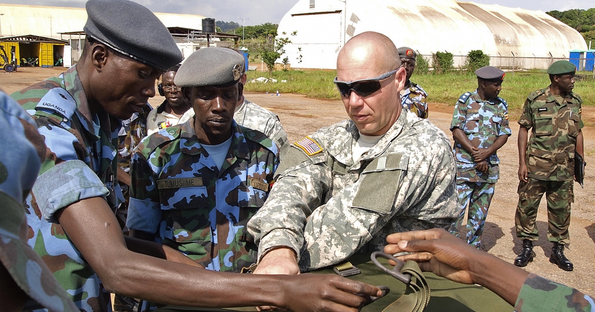 US soldiers assist Ugandan military personnel in the fight against the LRA. Encouragement of an American military presence in Uganda is a sticking point with critics of the Kony 2012 campaign.</p>