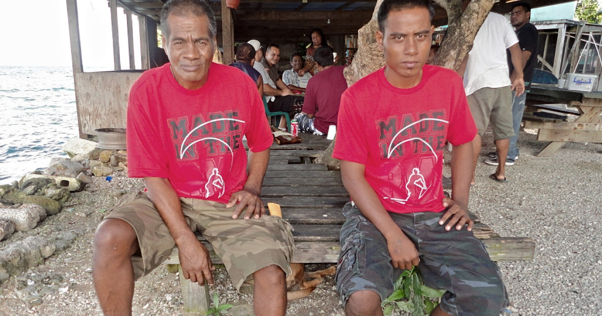 Kiribati fishermen Uein Buranibwe (L), 53, and Temaei Tontaake, 26, who survived a 33-day drift on the ocean sit together after they arrived in Majuro on December 11, 2011. The two Kiribati fishermen recounted their struggle for survival while drifting for 33 days in the Pacific before being washed ashore on a remote atoll and solving a 50-year family mystery.</p>