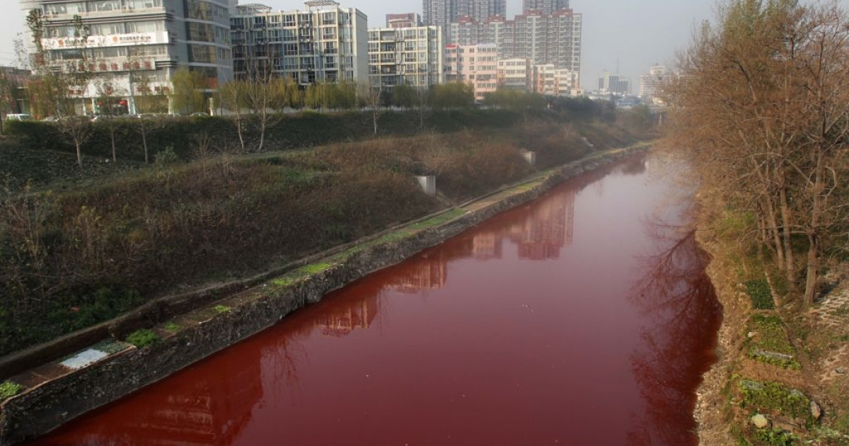 This picture taken on December 13, 2011 shows the red polluted Jian River in Luoyang, north China's Henan province. The cause of the river becoming apocalyptic in character was red dye being dumped into the city's storm water pipe network, by two illegal dye workshops,the Luoyang Municipal Environmental Protection Bureau said on December 14, 2011, as authorities said they were working to shut down the workshops, and to disassemble the workshops' machinery.</p>