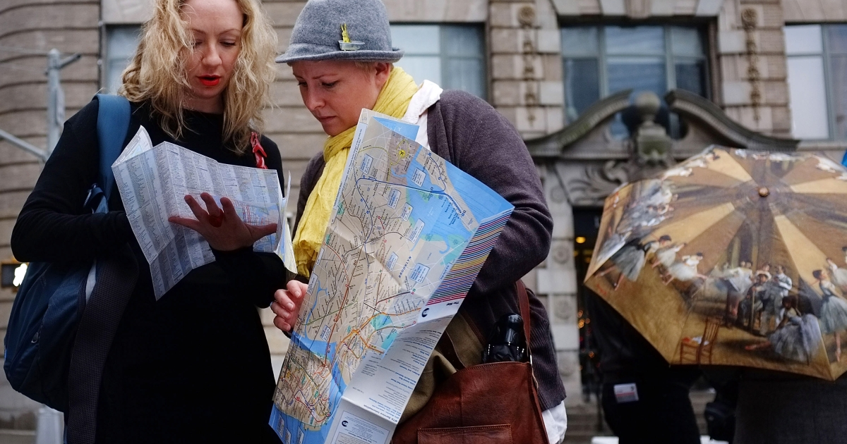 Two women from Australia look at a map of Manhattan on December 21, 2011 in New York City.</p>