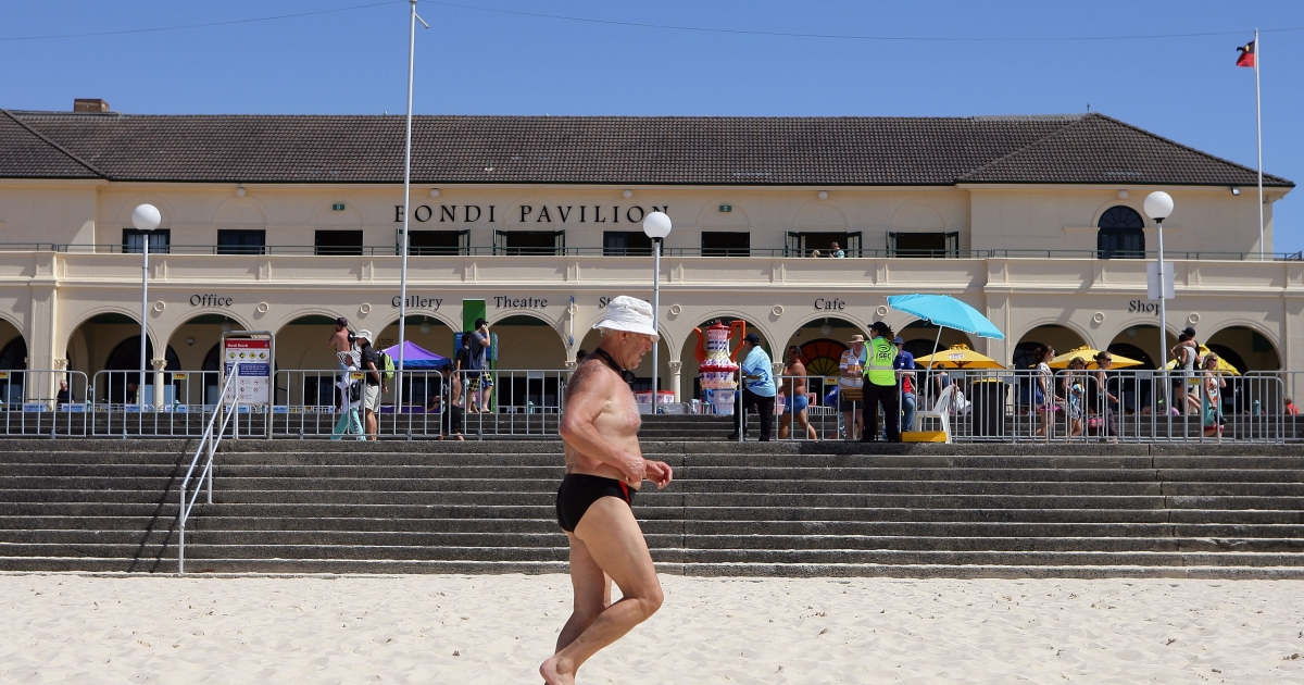 A man jogs along the sand at Bondi Beach on December 25, 2011 in Sydney, Australia.</p>