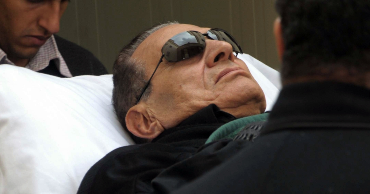Ousted Egyptian President Hosni Mubarak is wheeled on a stretcher into court for his murder trial in Cairo on Jan. 5, 2012.</p>