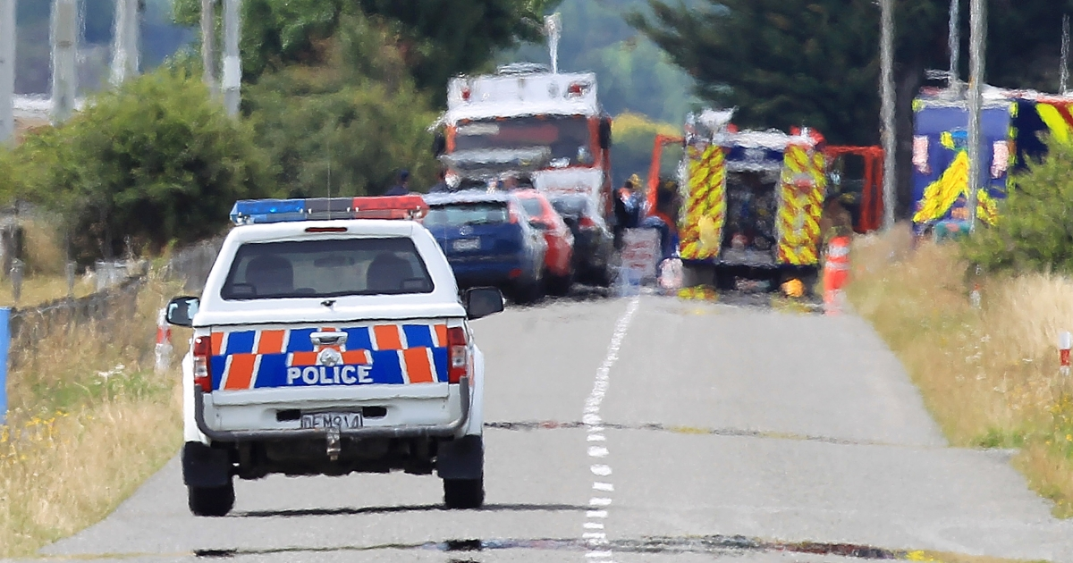 A Police vehicle drives through the cordon heading to the accident site on January 7, 2012 in Carterton, New Zealand. Emergency services attended a hot air balloon crash that has killed 11 people in the early hours of Saturday near the Wairarapa plains town of Carterton. The balloon burst into flames and crashed killing all aboard.</p>