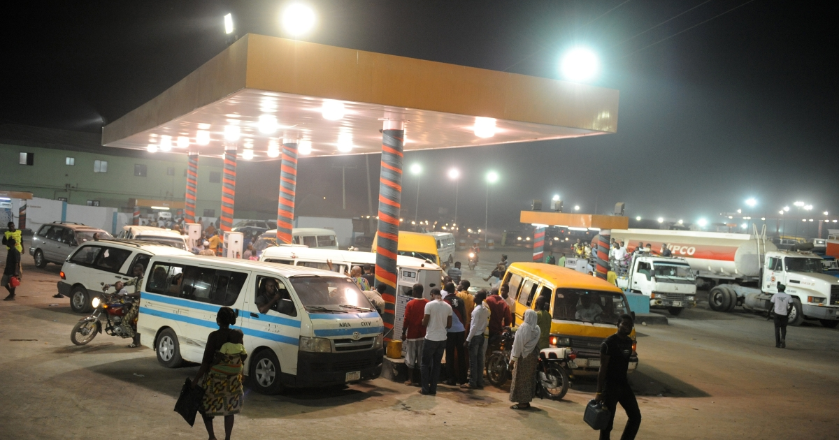 Motorists line up at a gas station on the eve of a strike launched by the labour and civil society to force the government to revert to old fuel pump price, on January 8, 2012 in Lagos.</p>