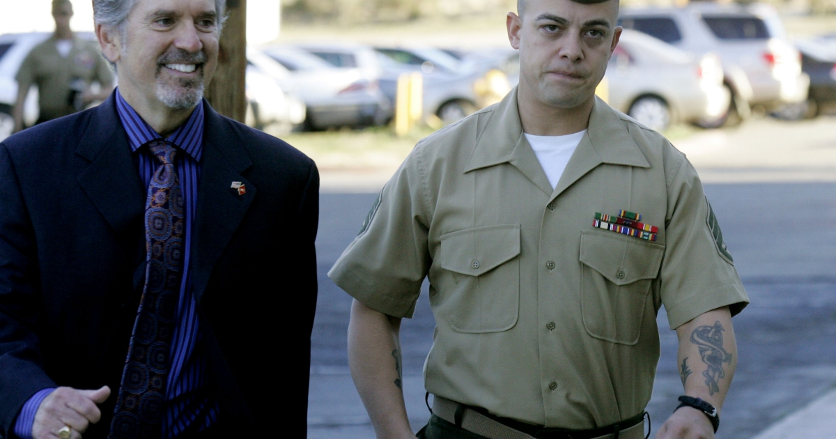Staff Sgt. Frank Wuterich (R) walks into court with his defense attorney Neal Puckette during opening statements in the Haditha murders trial at Camp Pendleton on January, 9, 2012 in Oceanside, California.</p>