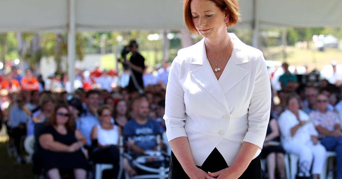 Australian Prime Minister Julia Gillard marks a moment of silence in memory of Australian flood victims.</p>
