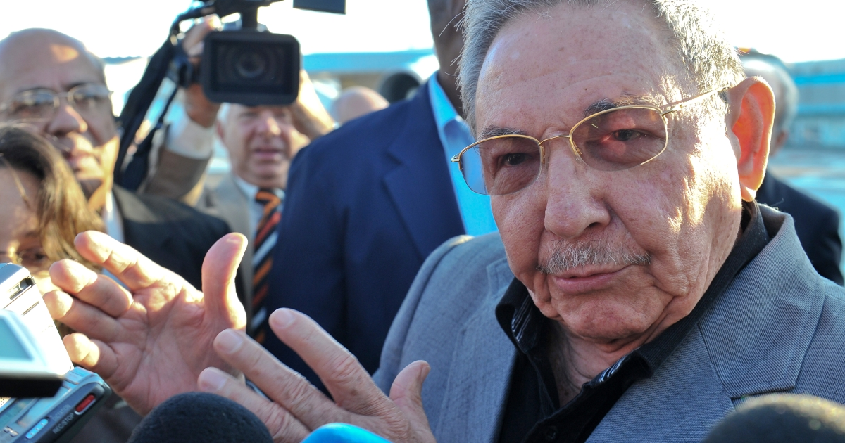 Cuban President Raul Castro speaks to the press at Jose Marti airport, on January 12, 2012, upon the departure from Cuba of Iranian President Mahmoud Ahmadinejad after an official visit.</p>