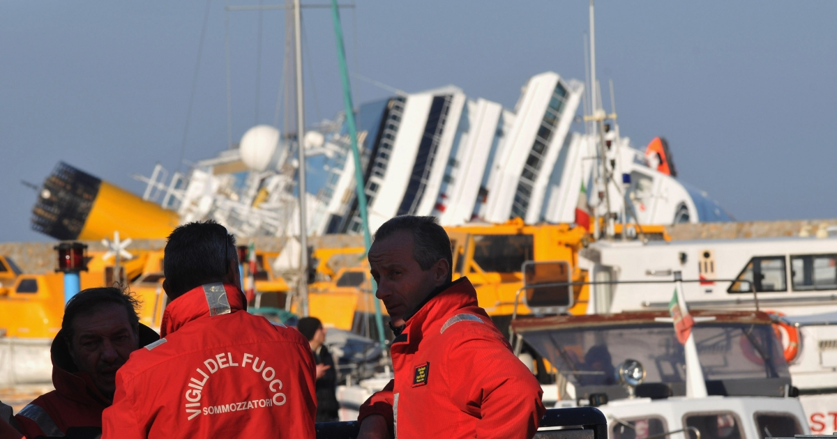 Rescue teams attend the site of the stricken cruise ship Costa Concordia offshore from the island of Giglio.</p>
