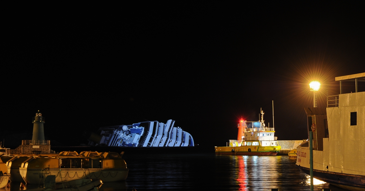 The cruise liner Costa Concordia pictured on the night of Jan. 16, 2012, lying in front of the harbor of Giglio island after hitting underwater rocks on January 13. Italian rescue workers on Monday suspended their search of the wreck of a stricken luxury liner three days after it crashed on the shores of Tuscany as the number missing was revised upward to 29.</p>