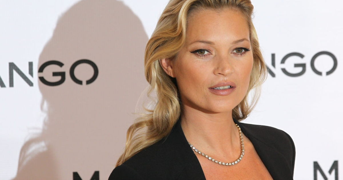 Model Kate Moss poses for photographs at the Mango Store Oxford Street on January 24, 2012 in London, England. Kate Moss was today launched as the new face of the fashion brand.</p>