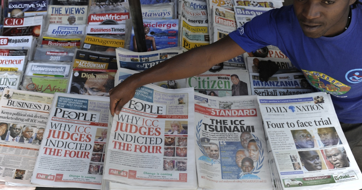 A Nairobi vendor sells newspapers detailing charges against four Kenyans accused of crimes against humanity by the International Criminal Court.</p>