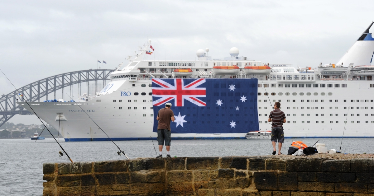 SYDNEY, AUSTRALIA — In this handout image provided by Carnival Australia, P&amp;O Cruises's Pacific Sun joins Sydney's Australia Day celebrations with the cruise ship 'dressed' with two of the biggest Australian flags ever displayed on the harbour, each measuring 44 metres by 22 metres, as she moored in the harbour during the early morning on January 26, 2012 in Sydney, Australia. Pacific Sun's Australia Day role in the celebrations comes as the countdown begins for the 'Sydney Festival of Cruising' throughout February, a record month for cruise ships in Sydney for the summer cruise season.</p>