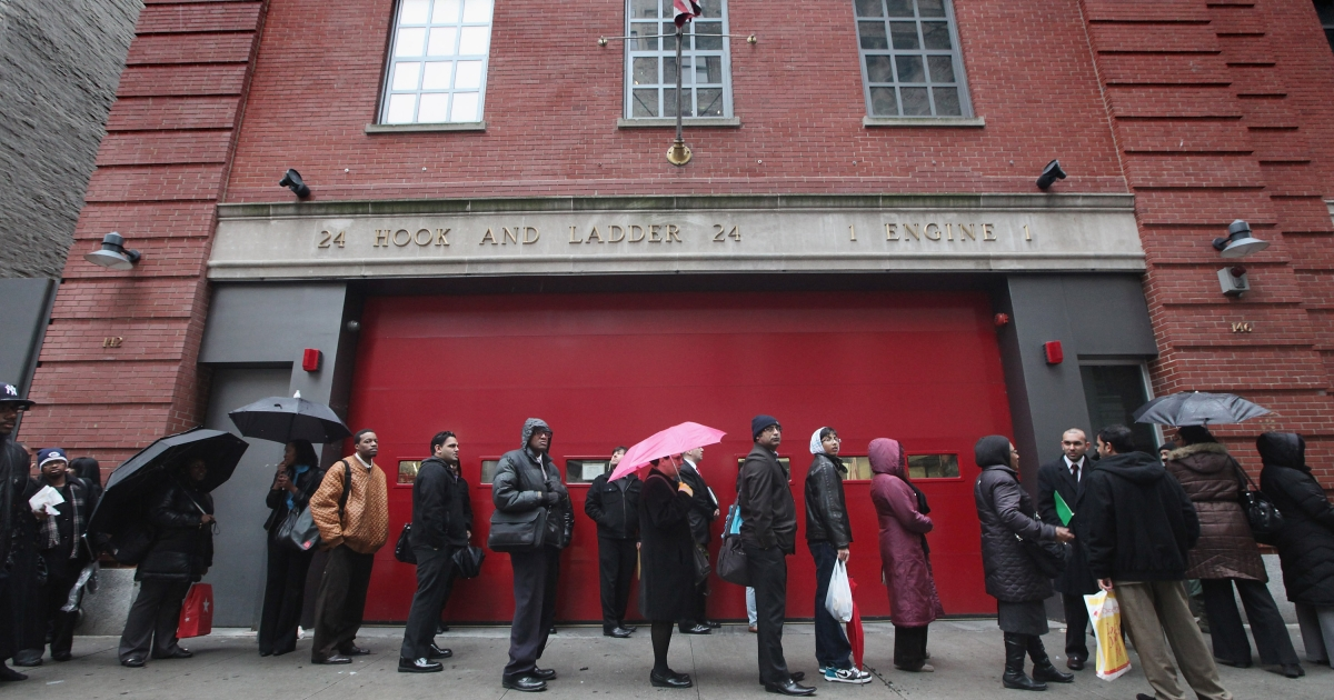 Employment seekers wait on line to attend a job fair in Manhattan on January 26, 2012 in New York City.</p>