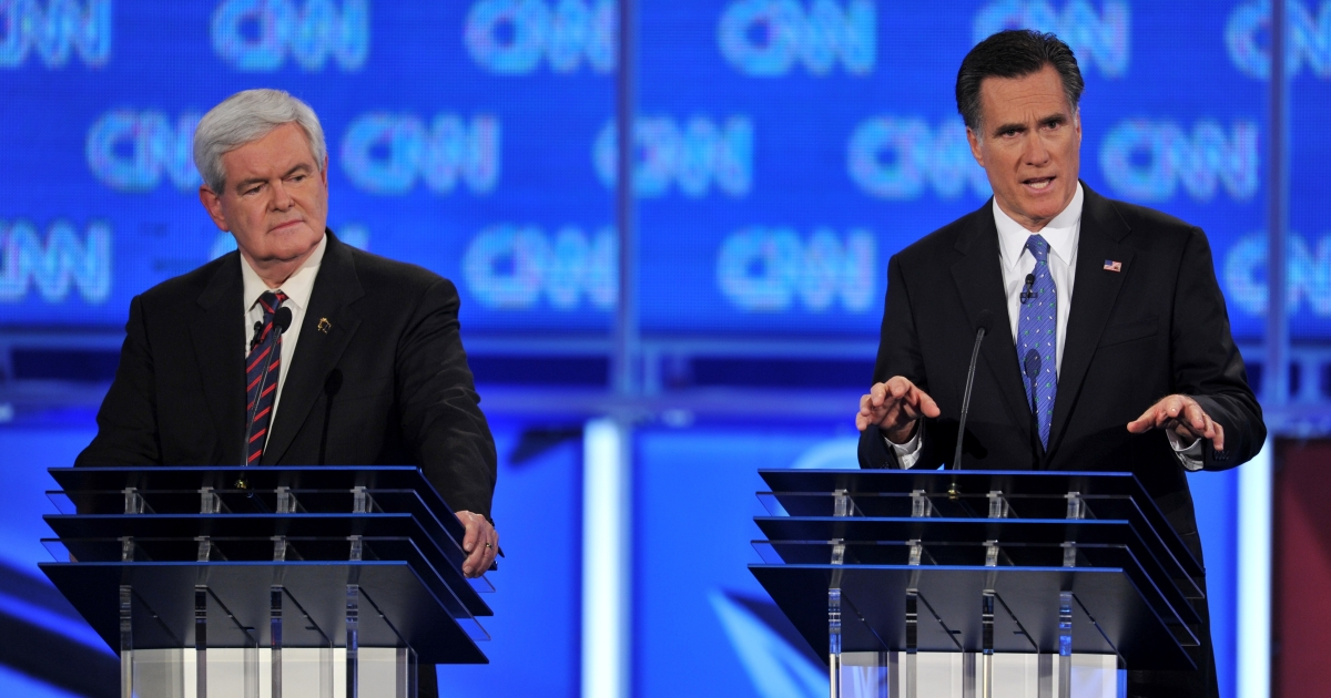 Republican presidential candidates, former House Speaker Newt Gingrich (L) listens to Mitt Romney (R) during the Florida Republican Presidential debate January 26, 2012 at the University of North Florida in Jacksonville, Florida.</p>