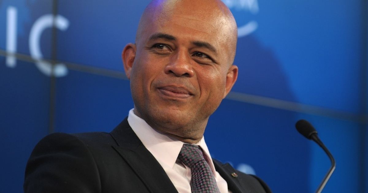 Haitian President Michel Joseph Martelly listens during a session 'Building a better Haiti'' at the WEF meeting 2012 in Davos on January 27, 2012.</p>