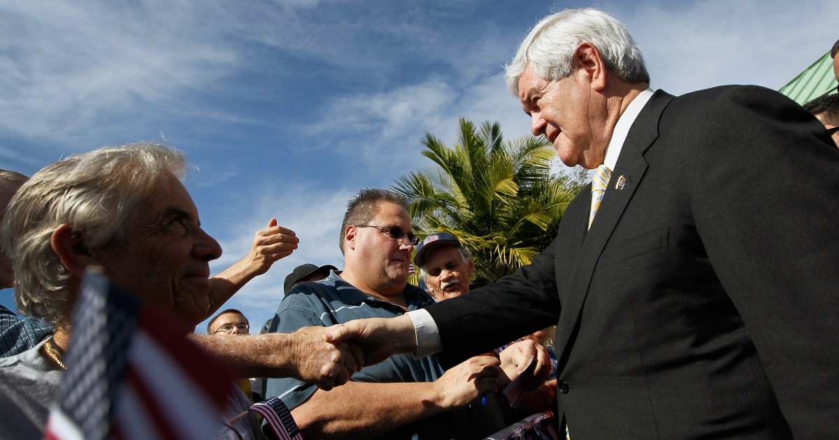 Republican presidential candidate, former Speaker of the House Newt Gingrich greets people during a meet and greet at the PGA Center for Golf Learning and Performance in Florida.</p>