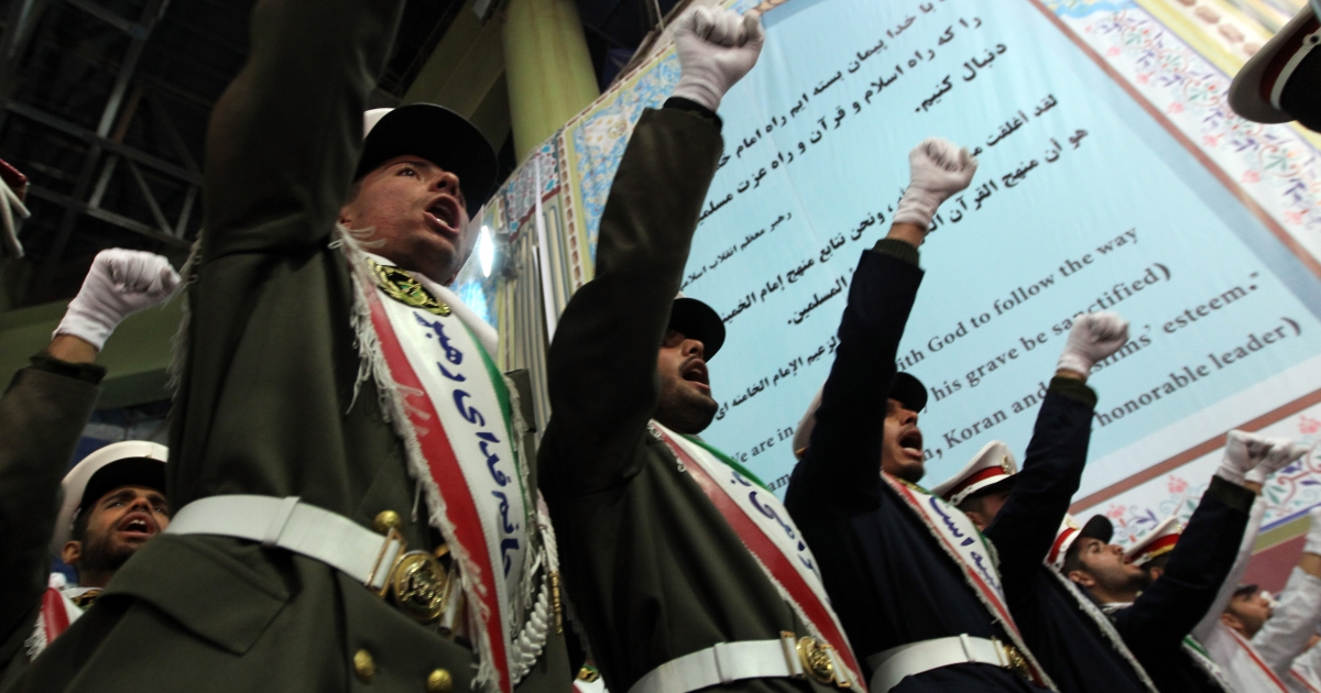 Iranian soldiers chant anti-Israeli and anti-US slogans on the first day of celebrations marking the 33th anniversary of Ayatollah Ruhollah Khomeini's return from exile at Khomeini's mausoleum in Tehran on February 1, 2012.</p>