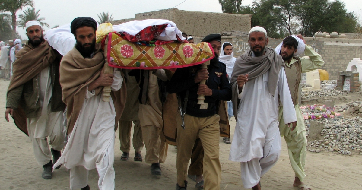 Pakistani security personnel and relatives carry a coffin of a policeman who was killed in a Taliban militant attack during his funeral in Lakki Marwat district, 140 miles southwest of the capital Islamabad, part of the troubled Khyber Pakhtunkhwa province that borders Afghanistan on February 2, 2012.</p>