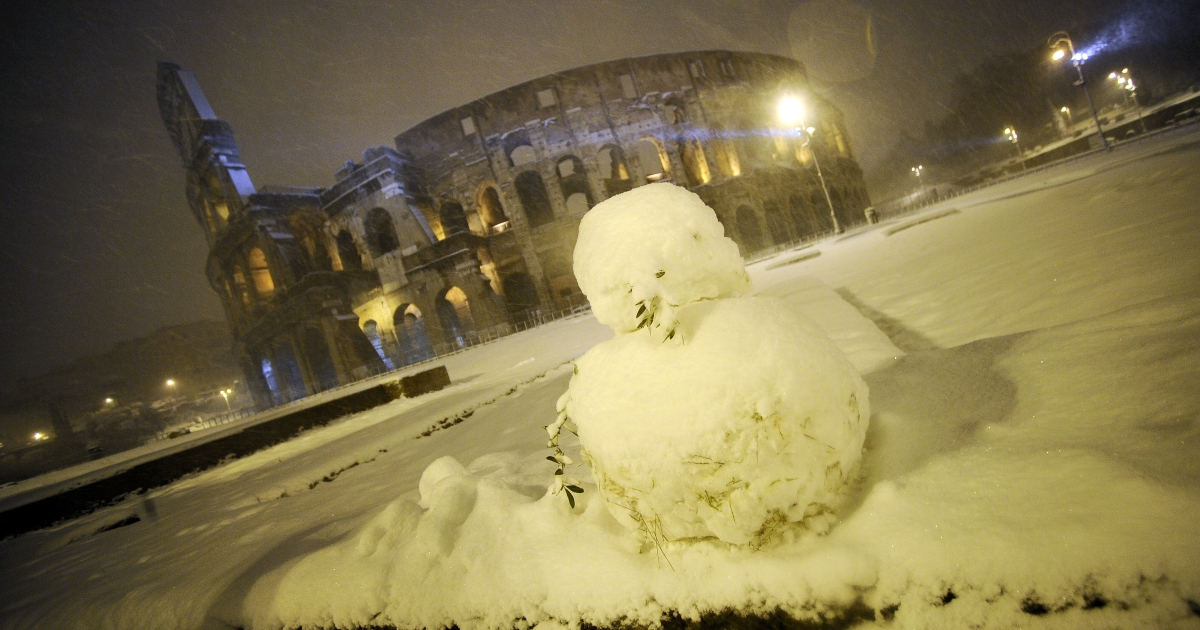 A photo taken on February 4, 2012 shows an snowman in front of the ancient Colosseum in Rome after a snowfall. A rare mantle of snow blanketed the historic center of Rome on February 3, forcing the closure of schools and tourist sites such as the Colosseum. The snow covered palm trees, ancient Roman ruins and Baroque churches across the normally mild-weather Italian capital which has only seen one snowfall in the past 15 years in which the snow stayed on the ground for a whole day.</p>
