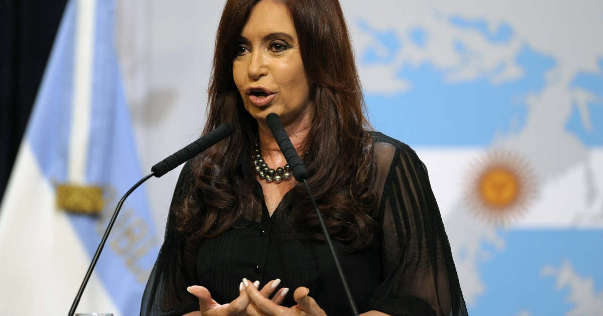 Argentine President Cristina Fernandez de Kirchner delivers a speech in front of a backdrop displaying the Falkland Islands (Malvinas in Spanish) painted like the Argentine national flag at the Government Palace in Buenos Aires on February 7, 2012.</p>
