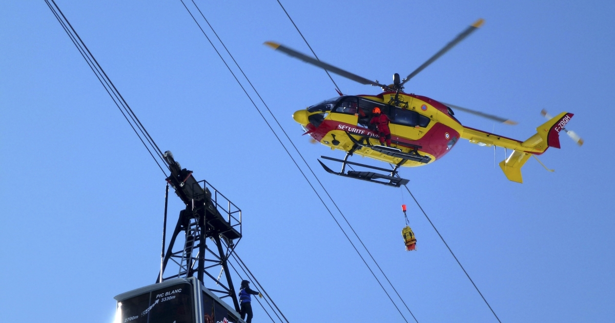 In a separate rescue, French gendarmes used a helicopter to evacuate people from a telecabin in the French ski resort of Alpe d'Huez on February 11, 2012.</p>