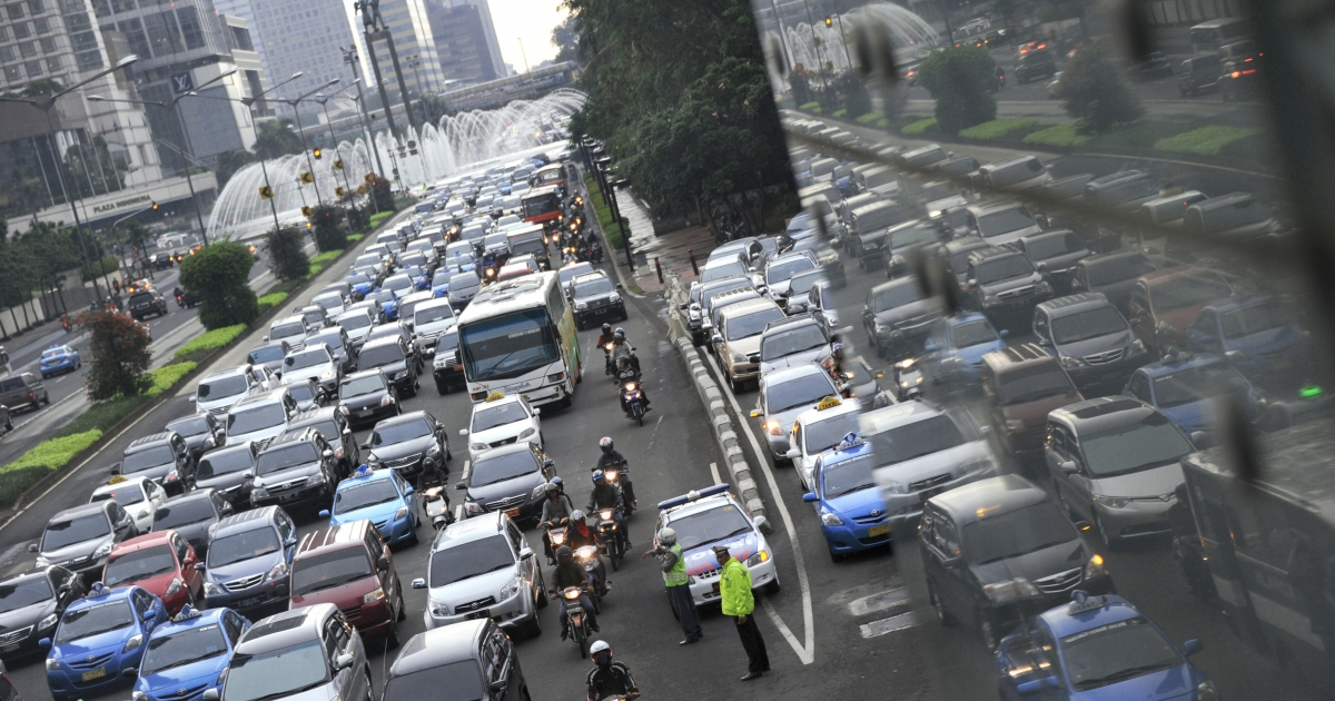 In this photograph taken on February 10, 2012 cars and public transports are jammed during rush hour traffic at Jakarta's main Thamrin avenue. Automakers from Japan to India are eyeing a bonanza in Indonesia, Southeast Asia's largest economy and a new growth market for cars.</p>