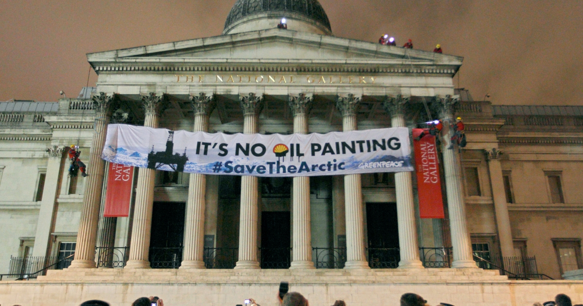 Greenpeace protesters scale the pillars of the National Gallery in central London, on February 21, 2012, as they unfurl a banner in protest at oil firm Shell's plans for drilling oil in the Arctic.</p>