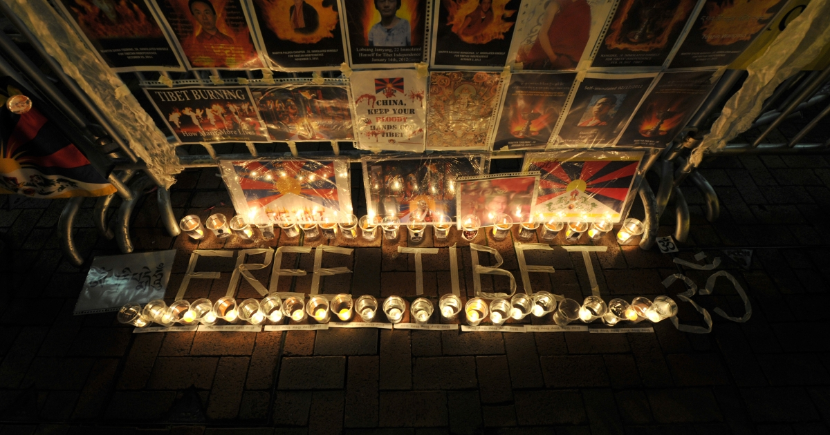 A Free Tibet candlelit display showing the pictures of Tibetans who died of self immolation is seen during a protest in front of the Liaison Office of the Central People's Government in the Hong Kong Special Administrative Region on February 22, 2012.</p>