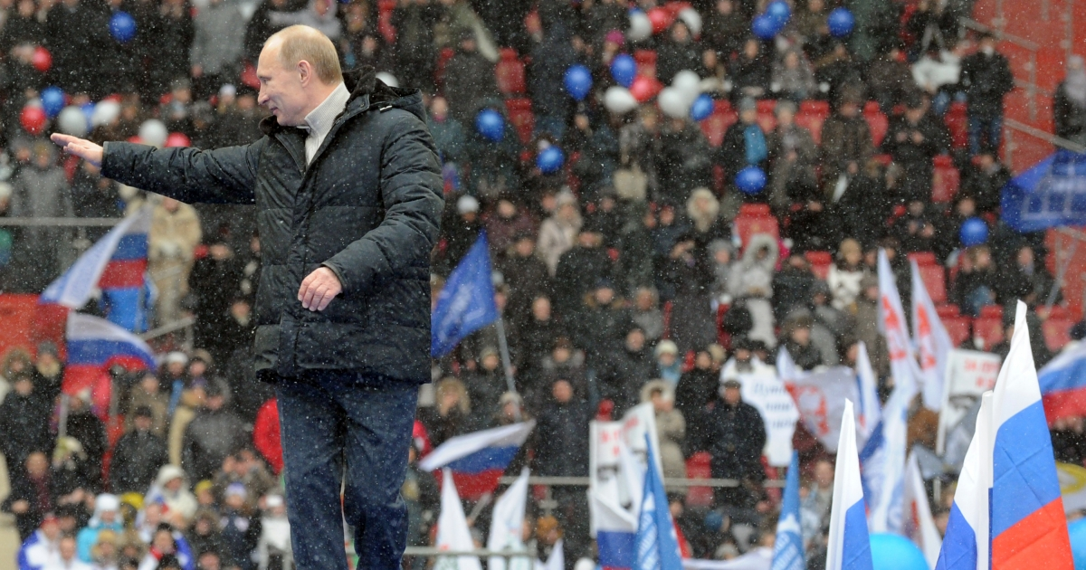 Russian Presidential candidate, Prime Minister Vladimir Putin gestures during a rally of his supporters at the Luzhniki stadium in Moscow on February 23, 2012.</p>
