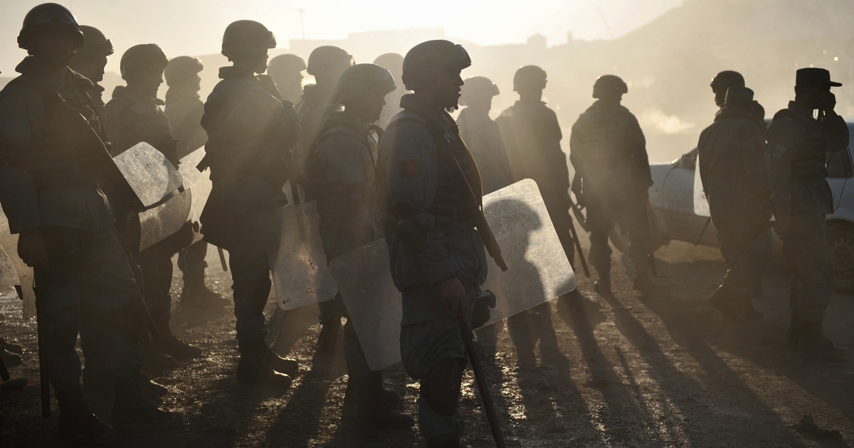 Afghan riot police stand guard during a protest against Quran desecration in Kabul on February 24, 2012.</p>