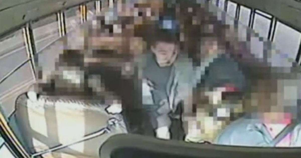This image from a school bus surveillance camera shows Jeremy Wuitschick, 13, steering the bus to safety after the driver's apparent heart attack.</p>