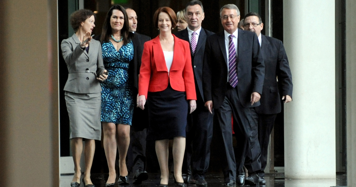 Prime Minister Julia Gillard arrives with supporters for the caucus meeting in Canberra, Monday, Feb. 27, 2012.</p>