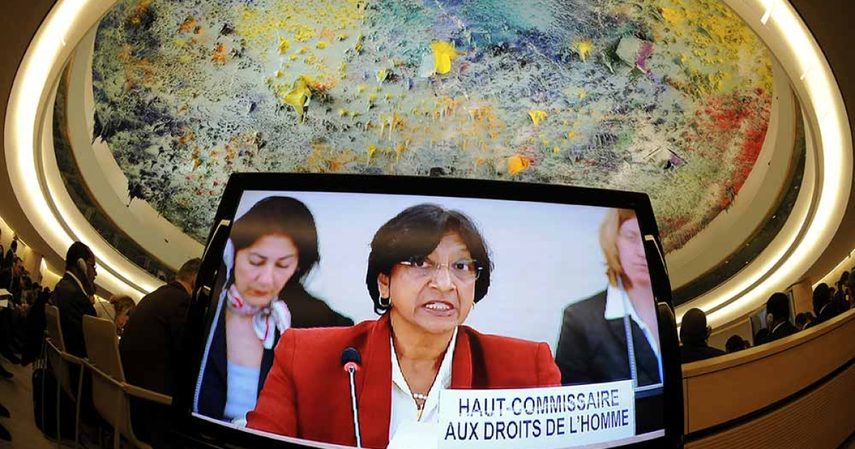 UN Commissioner for Human Rights Navi Pillay appears on a TV screen at the opening of a session of the United Nation Human Rights Council on February 27, 2012 in Geneva.</p>