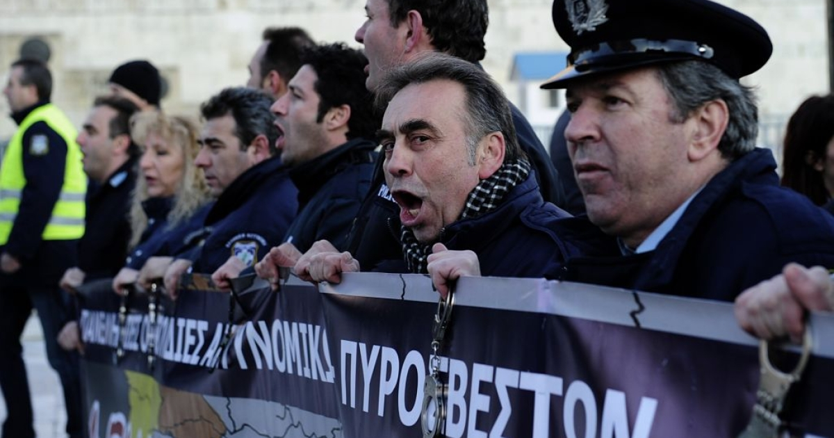 Policemen shout slogans during a demonstration of Greek security forces against the new austerity measures in Athens on February 28, 2012.</p>