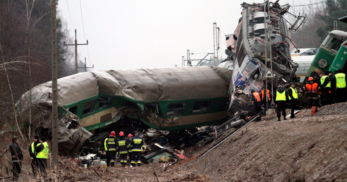 Rescuers work at the scene of a train crash in Szczekociny near Zawiercie (Silesia) in Poland today. Two passenger trains collided late Saturday, injuring more than 60 passengers. At least 16 people died.</p>