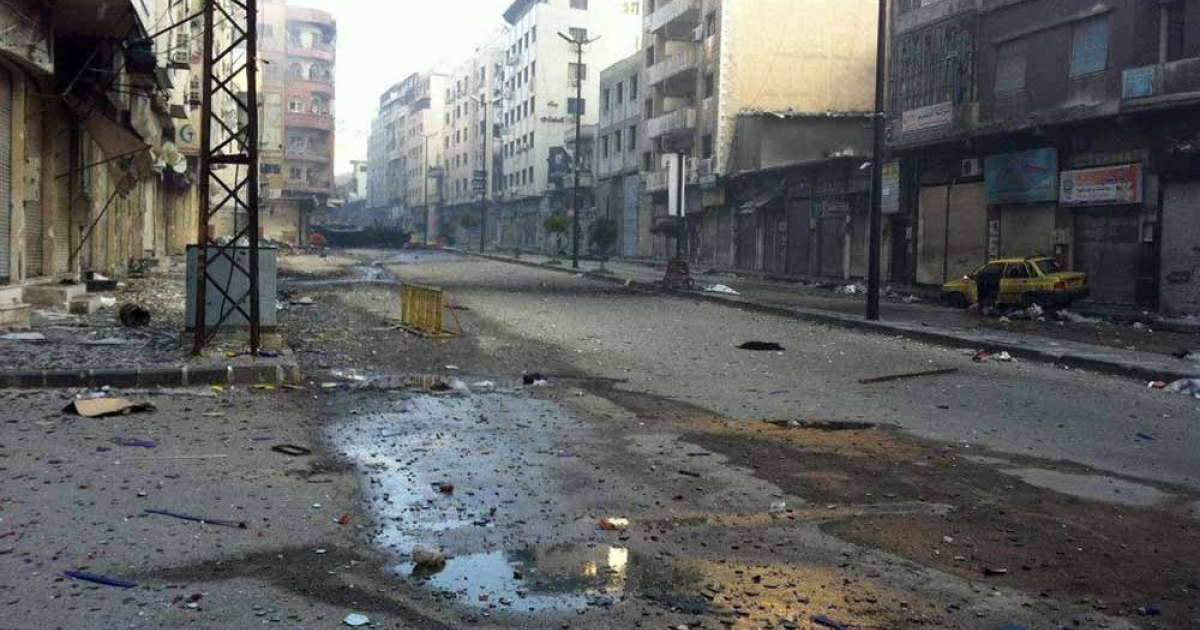 A view of a deserted street strewn with debris in the restive city of Homs, some 160kms north of the Syrian capital Damascus on February 25, 2012. China called for an end to violence in Syria on March 4, 2012, as the regime of Bashar al-Assad sparked international outrage by blocking aid from reaching the battered Baba Amr flashpoint in Homs city. -/AFP/Getty Images</p>