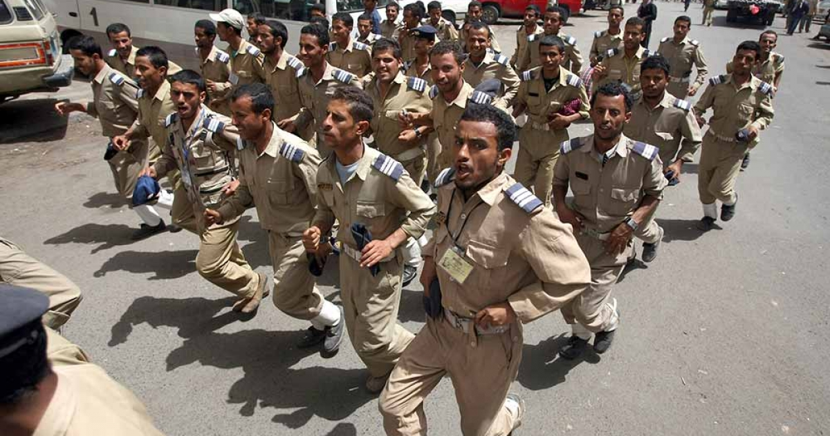 Yemeni air force soldiers march during a protest in the capital Sanaa, on March 4, 2012, demanding the ouster of military chiefs over accusations of corruption. MOHAMMED HUWAIS/AFP/Getty Images</p>