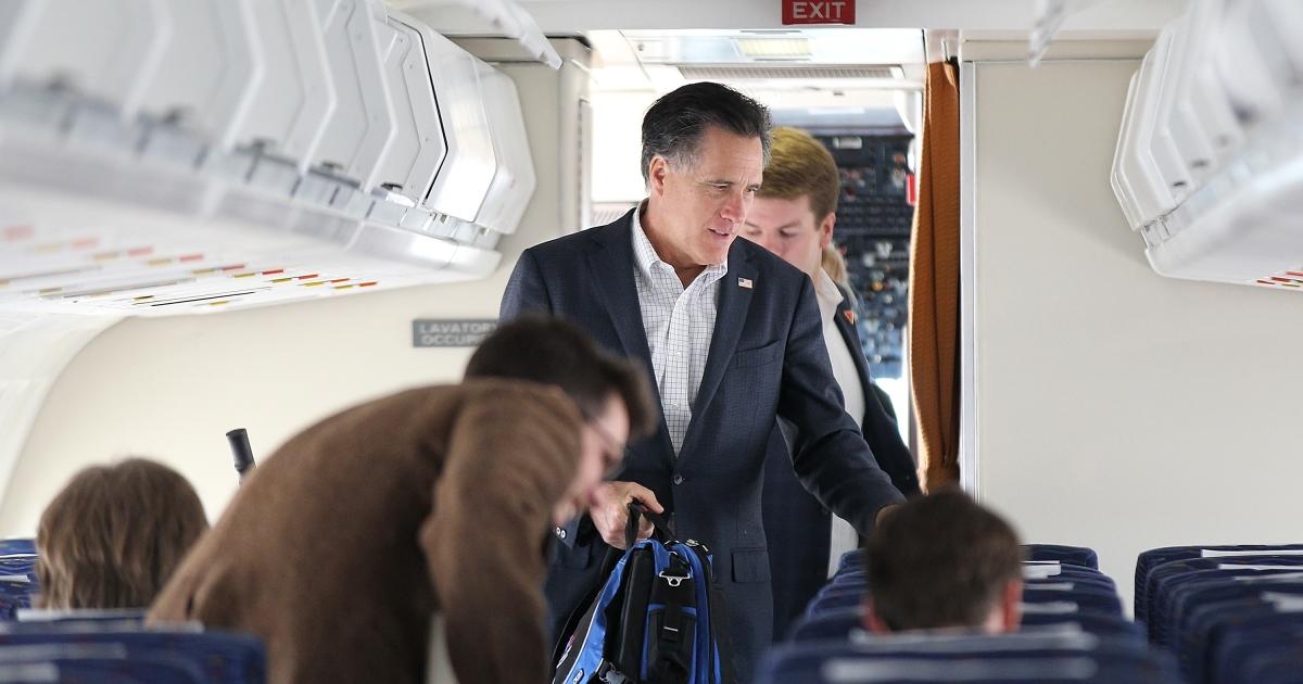 Republican presidential candidate, former Massachusetts Gov. Mitt Romney boards his campaign plane March 4, 2012 in Atlanta, Georgia.</p>