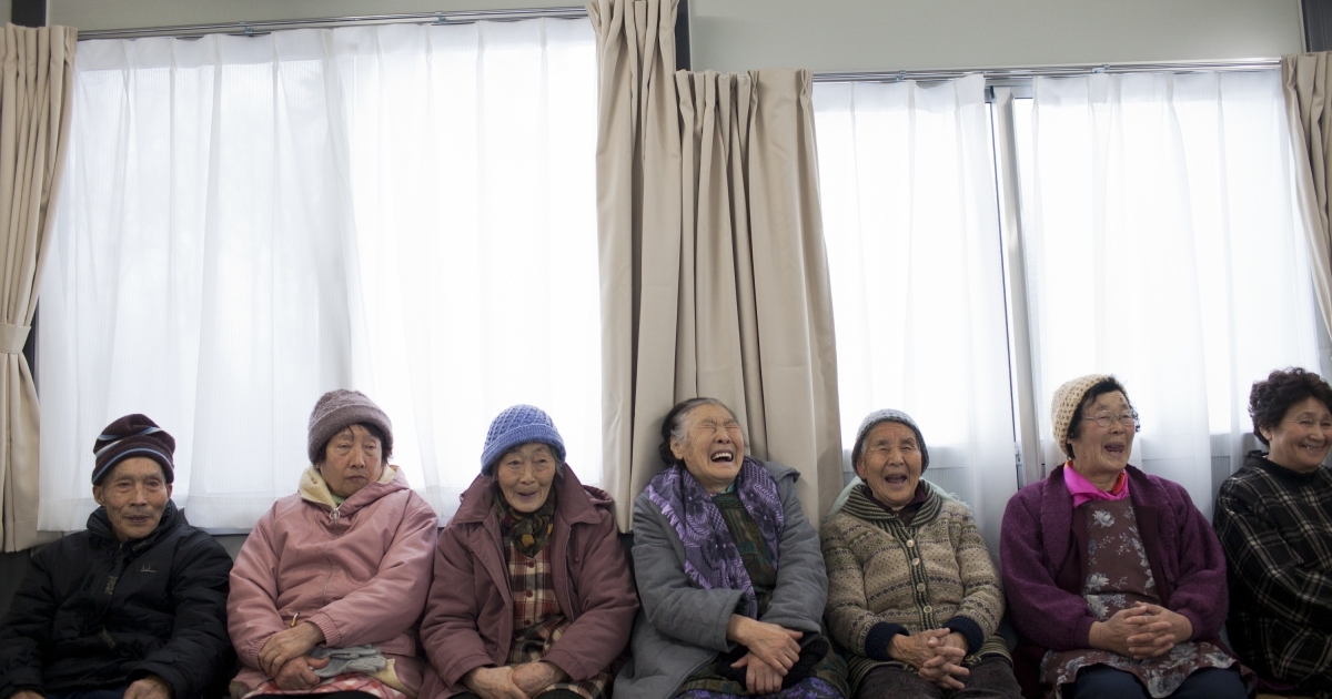 Elderly Japanese people mingle at a community centre in Minamisanriku, Japan, on March 5, 2012.</p>