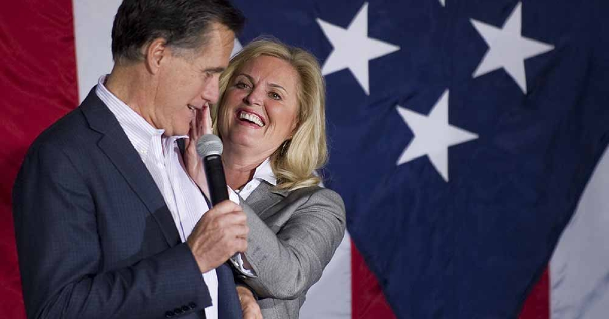 Ann Romney wipes lipstick off Republican presidential candidate Mitt Romney's cheek as he prepares to speak at a rally in Zanesville, Ohio, March 5, 2012, ahead of voting on Super Tuesday. JIM WATSON/AFP/Getty Images</p>