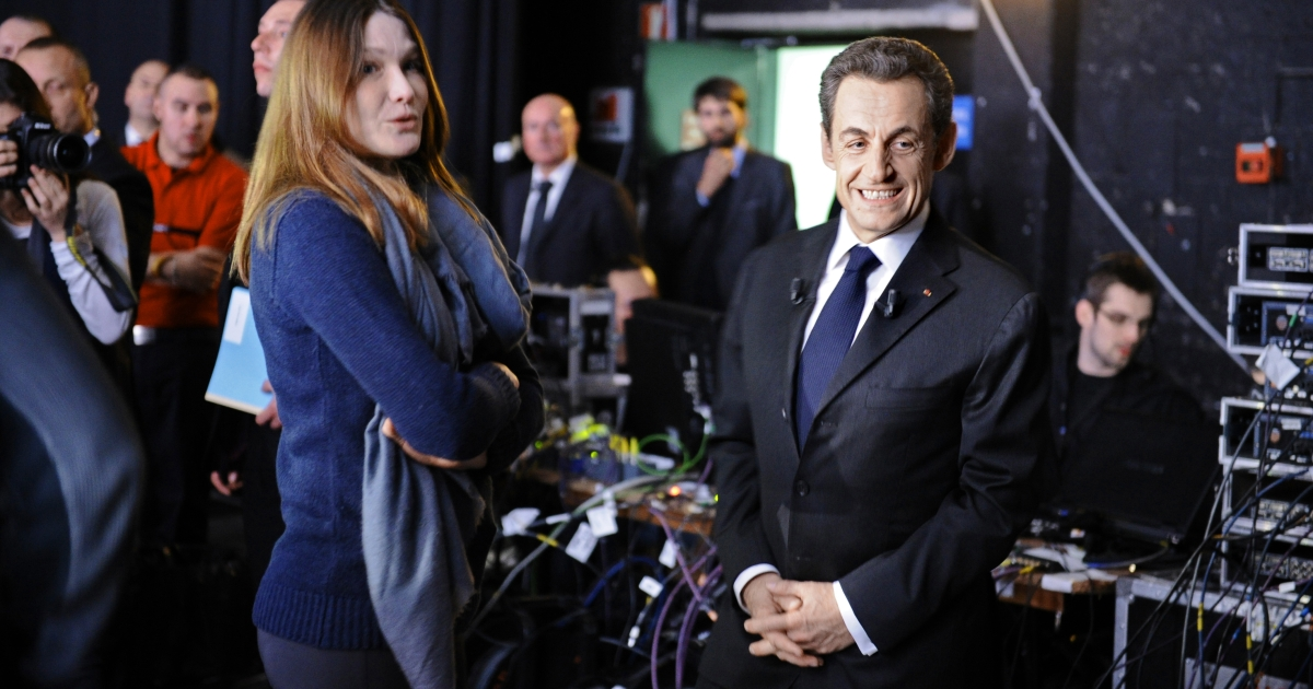 France's incumbent president and UMP ruling party candidate for the 2012 presidential election Nicolas Sarkozy (R) waits beside France's First Lady Carla Bruni-Sarkozy before taking part in the TV broadcast show 'Des paroles et des actes' of French TV channel France 2 on March 6, 2012 in Paris.</p>