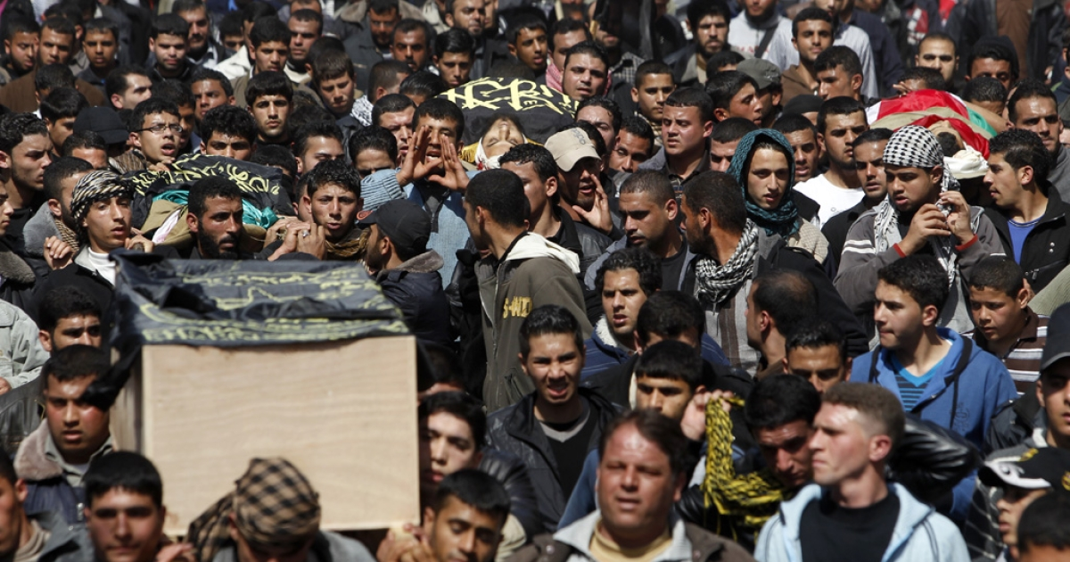 Palestinian mourners carry the bodies of seven Islamic Jihad militants today in Gaza City. As many as 15 Palestinian fighters died and 20 people wounded in a series of Israeli air strikes on the Gaza Strip that began on Friday.</p>