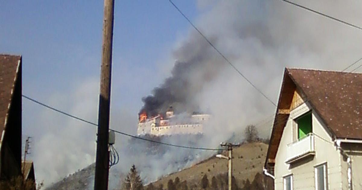 The Krasznahorka castle above the village of Krasnohorske Podhradie burns after allegedly being sparked by two children smoking.</p>