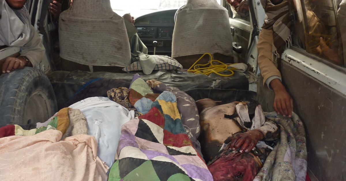 The bodies of Afghan civilians allegedly shot by a rogue US soldier are pictured in the back of a van in Alkozai village of Panjwayi district, Kandahar province on March 11, 2012.</p>