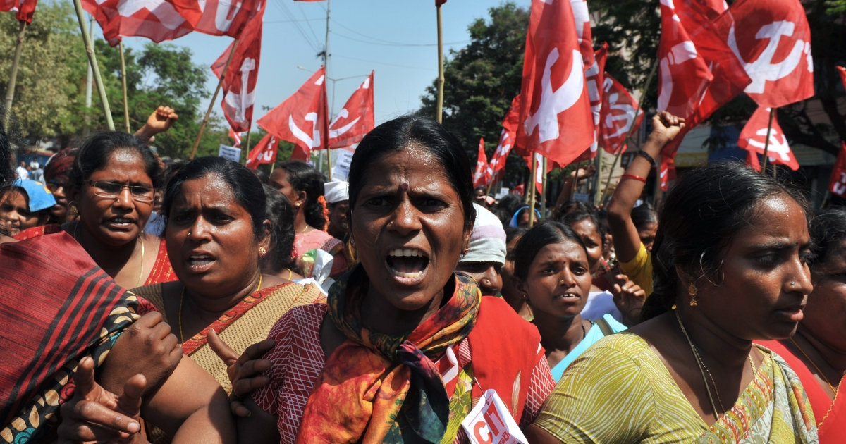 Women of the Andhra Pradesh Voluntary Health Workers' Union shout slogans during a protest as they head towards the state legislative assembly building in Hyderabad, India on March 12, 2012. The demonstrators demanded immediate implementation of increased wages and regular monthly payments, uniforms, travelling and daily allowances.</p>