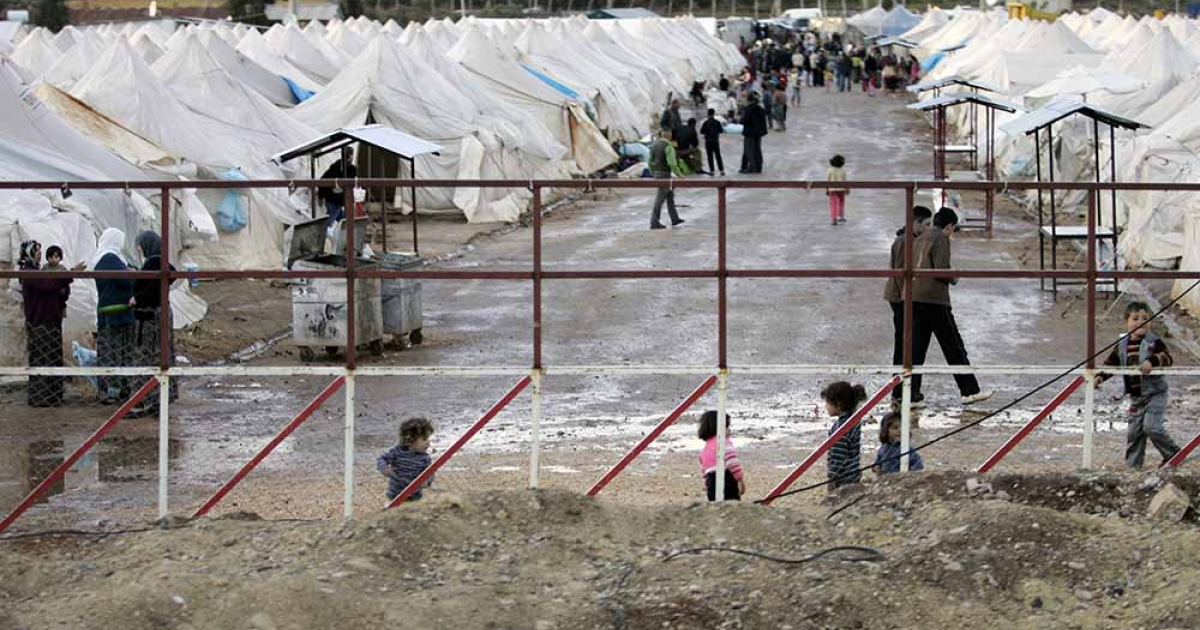 Syrian refugees who fled the violence in Idlib region, walk amid make-shift tents in a camp set by the the Turkish army near Kavalcik, on the border between Syria and Turkey, on March 14, 2012. Turkey has started building a new camp site for 20,000 Syrian refugees in the southeastern province of Sanliurfa, Turkish officials said, after the latest influx of refugees came as Syrian troops overrran the northwestern city of Idlib.</p>