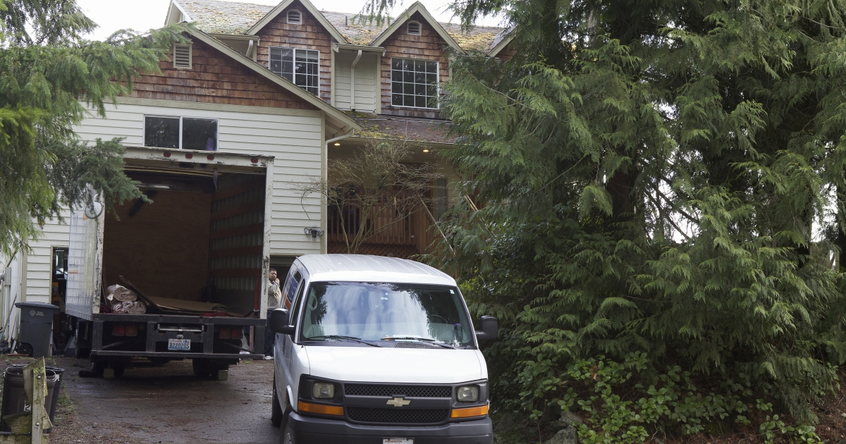 The home of Robert Bales is pictured with a pair of moving vans outside March 19, 2012 in Lake Tapps, Washington.</p>